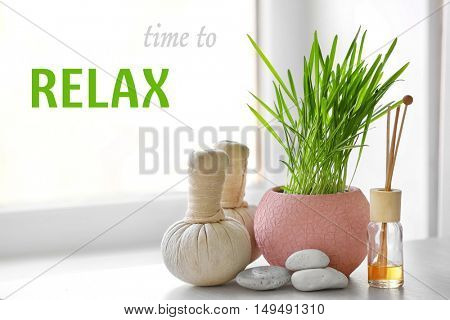 Spa composition on window sill. Text TIME TO RELAX on blurred background.