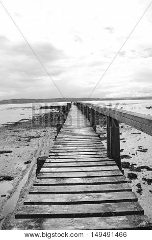 A view along an old wooden pier at Culross
