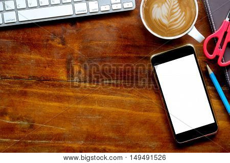 blank screen mobile phone on work table.
