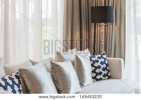 Set Of Pillows And Sofa In Classic Living Room Syle