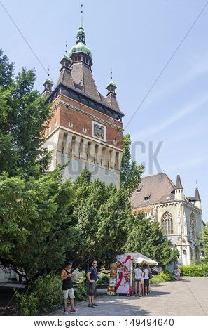 BUDAPEST, AUGUST 9: Tourists enjoying the beautiful weather visit Vajdahunjad Castle on August 9, 2015 in Budapest, Hungary. Vajdahunyad Castle is located in the City Park.