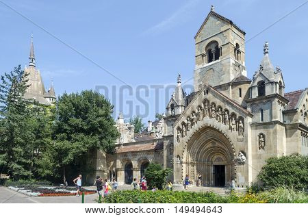 BUDAPEST, AUGUST 9: Tourists enjoying the beautiful weather visit Chapel in castle Vajdahunjad on August 9, 2015 in Budapest, Hungary. Vajdahunyad Castle is located in the City Park.