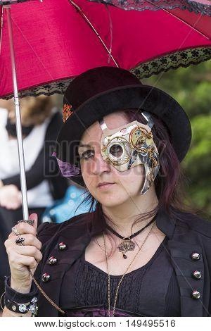 CAGLIARI, ITALY - June 1, 2014: Sunday at La Grande Jatte public gardens - Sardinia - portrait of a woman in steampunk costumes