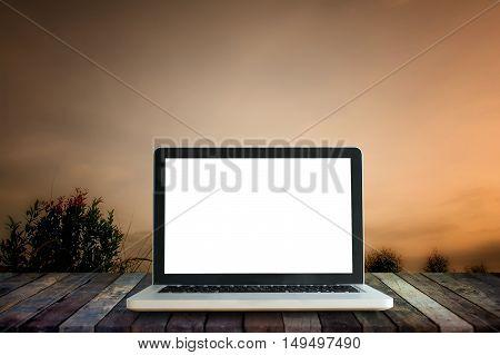 Laptop computer mock up over Sun set landscape and terrace