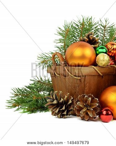Wooden basket with colorful holiday ornaments pine cones balls tinsel. Isolation on a white background. Festive composition with natural decorations.