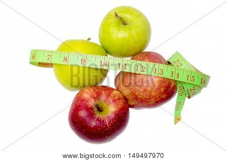 Two Green Apples, Two Read Apples And Measuring Tape Isolated On White.