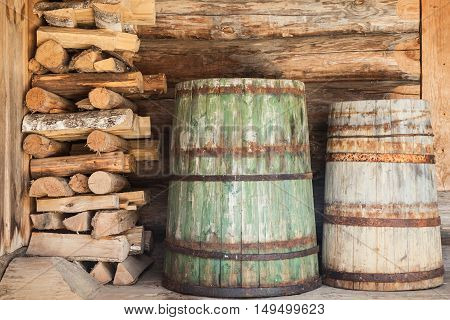 Old Wooden Barrels And Firewood