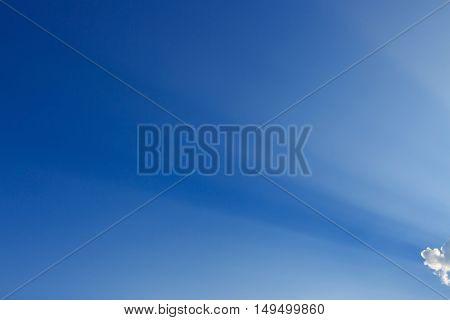 Light Rays On Clear Blue Sky Background