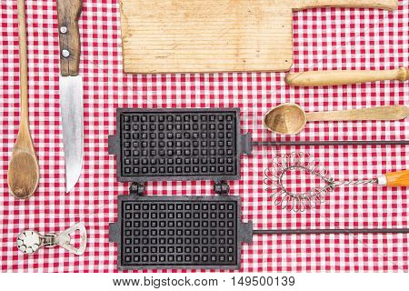 Vintage kitchen equipment on a diamond red and white fabric