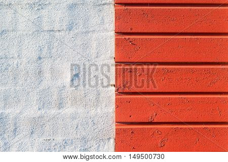 Painted white brick wall and red wooden wall texture