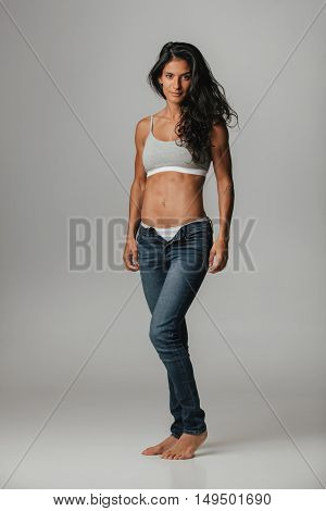 Woman In Jeans And Halter Top Stares At Camera