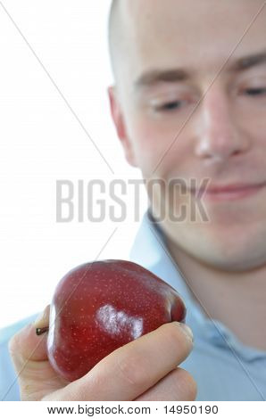 Young Man Eating Fresh Apple Isolated