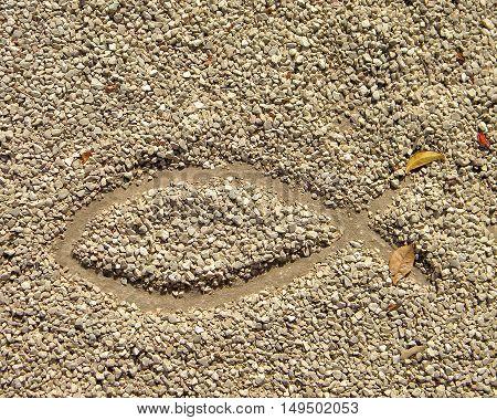 Fish symbol in drawn in the sand in Israel desert
