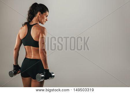 Rear Three Quarter View Of Female Bodybuilder