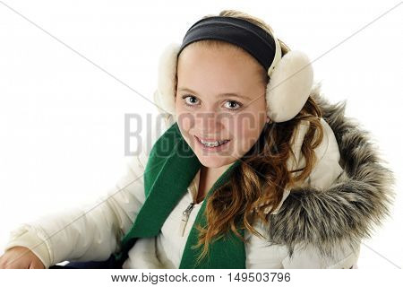 Overhead view of a pretty preteen dressed for winter.  On a white background.
