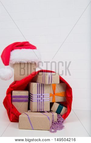 a lot of gifts in the bag from Santa Claus
