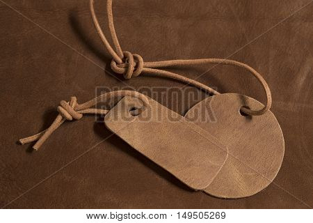 Two leather labels on a leather background