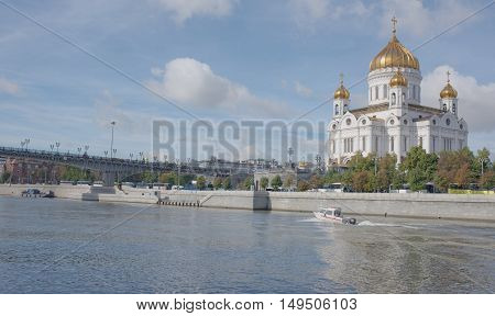 Moscow Russia -September 06 2016: Christ Temple Saviour.On the river floats boat