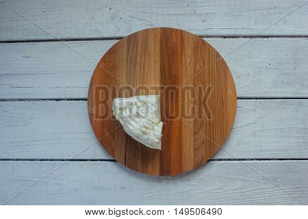 Traditional indian cheese panneer prepared form fresh milk on wooden board