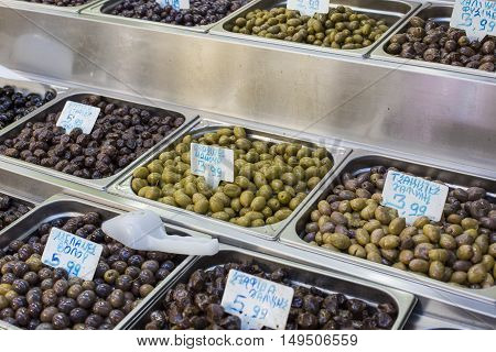 Olives and olive oil for sale at a market for farm products.