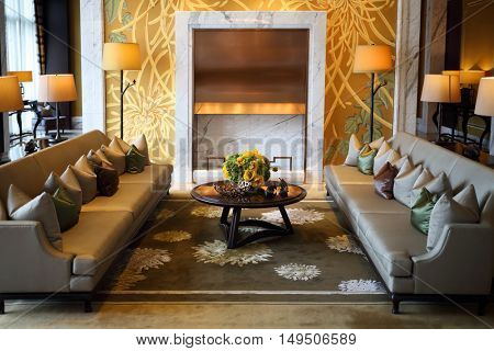 SHANGHAI - NOV 05, 2015: Stylish room with two couches, small table and lamps IFC Residence hotel