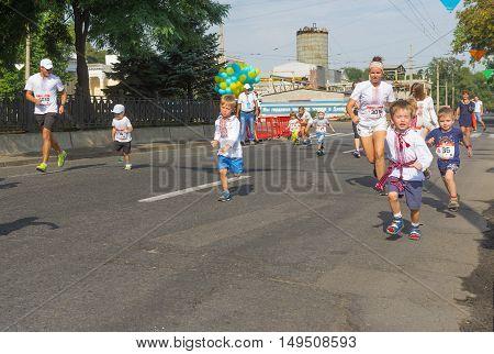 DNEPR ULRAINE - AUGUST 24, 2016: Kids running in Vyshyvanka Run during Independence Day local activity in Dnepr Ukraine at August 24 2016