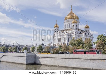 Moscow Russia -September 06 2016: Christ Temple Saviour.Citizens are moving on the bridge and the other citizens and vehicles moving along the waterfront