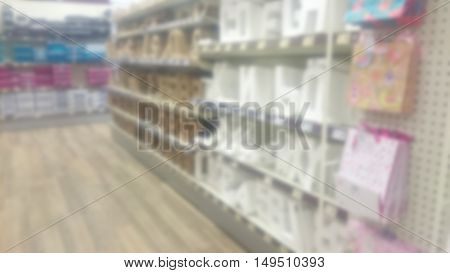 Stacked shelves inside a craft shop. Out of focus.