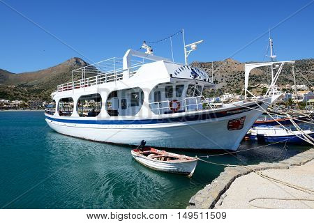 PLAKA GREECE - MAY 14: The motor yacht tour to Spinalonga island on May 14 2014 in Plaka Greece. Up to 16 mln tourists is expected to visit Greece in year 2014.