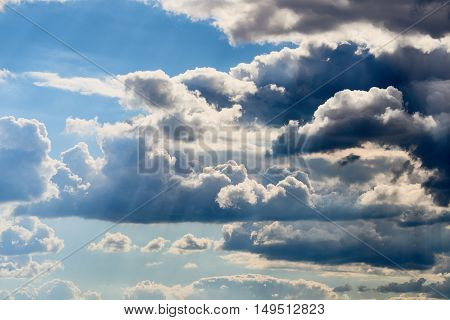 Vivid and dramatic clouds with blue sky shining through.