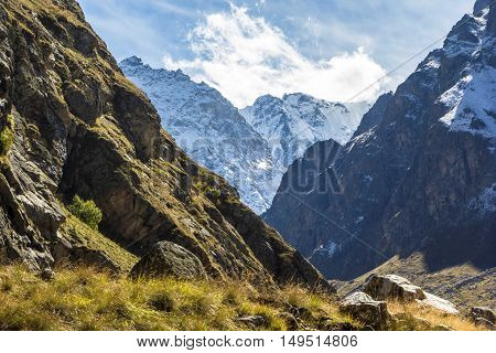 mountain landscape, gorge, snow tops, slopes, wild nature