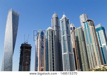 Dubai, United Arab Emirates - October 17, 2014: Skyscrapers on the artificial city district Dubai Marina