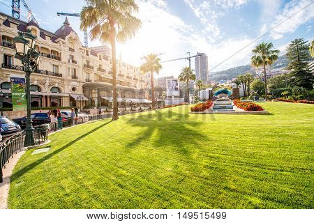 Monte Carlo, Monaco - June 13, 2016: Casino square with palms and fountain on the sunset in Monte Carlo in Monaco.