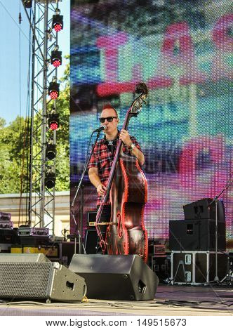 St. Petersburg, Russia - 12 August, Pop musician with a contrabass,12 August, 2016. Pop and rock musicians on Harley Davidson festival in St. Petersburg.