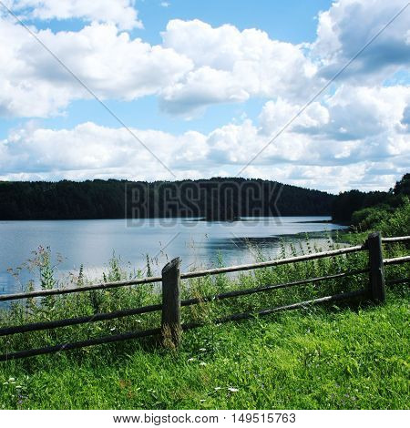Wooden Fence On The Hill And View At Kenozero Lake