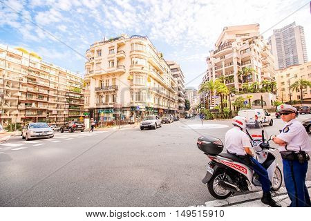 Monte Carlo, Monaco - June 13, 2016: Policemen keep security on the road crossing in Monte Carlo in Monaco