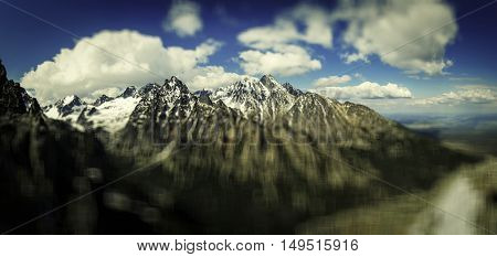 Panoramic view of the rugged snow capped mountains. Vintage effect. Vignetting effect. Bokeh. Blurred effect. High Tatras Slovakia