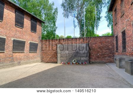 OSWIECIM POLAND - MAY 12 2016: Death Wall in concentration camp Auschwitz-Birkenau in Oswiecim Poland.