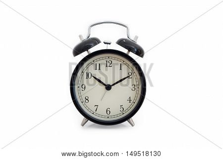 A black alarm clock on white background