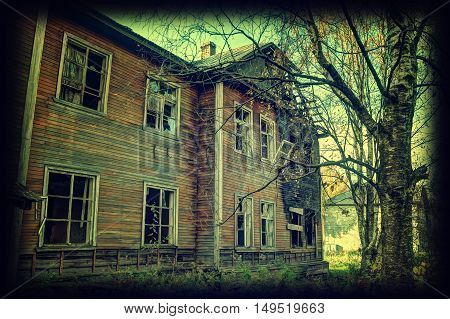Old destroyed house. Photos in retro style.