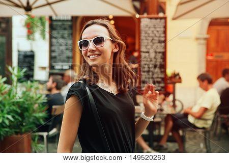 Smiling Woman On The Background Of European Old Town Street. Ljubljana, Slovenia
