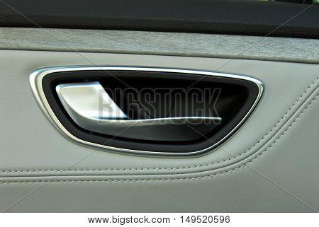 handle to open the door in a luxury car
