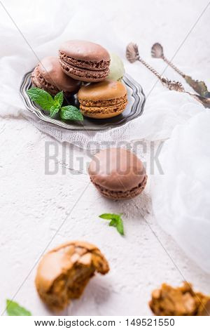 Cake macaron or macaroon on light background, colorful almond cookies, vintage card, holiday food concept, copy space for text.