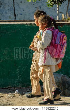 Hurghada, Egypt - November 7. 2006: Girls come back home from school