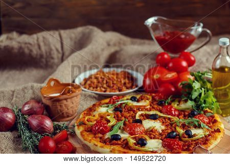 Pizza Bolognese On A Wooden Board.