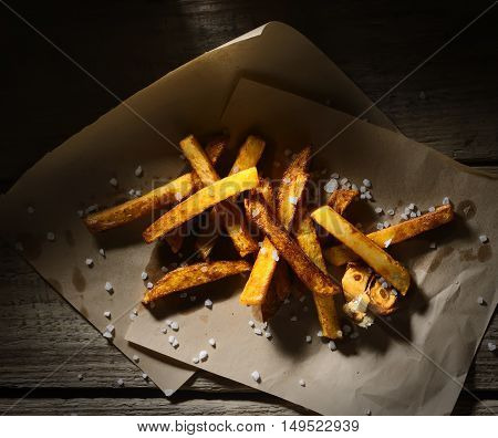 flavored french fries on a wooden surface
