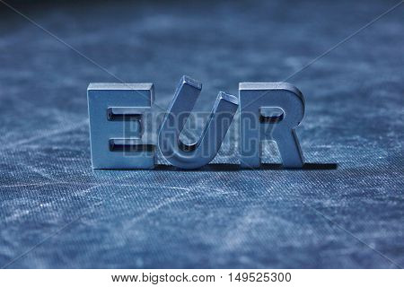 letters on silver background spelling EUR