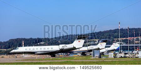 Kloten, Switzerland - 29 September, 2016: Gulfstream jets standing in Zurich Airport (also known as Kloten Airport). Gulfstream business jet aircrafts are designed and manufactured by Gulfstream Aerospace Corporation.