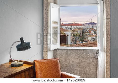 Interior retro stle setting by the window showing outside view of Porto