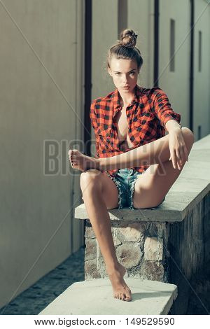 Sexy Girl On Stone Fence